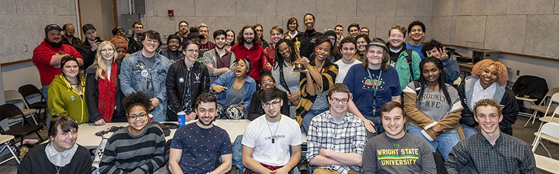 photo of students with alumna hannah beachler and her oscar